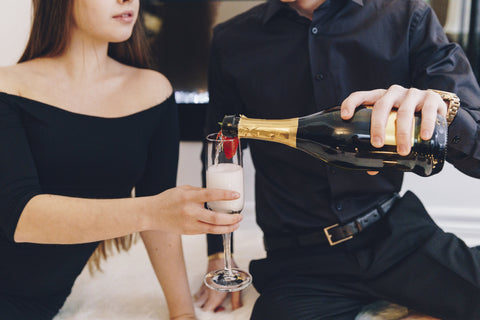couple pouring champagne