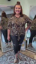 Load and play video in Gallery viewer, Brown Animal Print Top with Tie in the Front