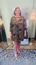 Load and play video in Gallery viewer, Animal Print Dress with Criss Cross Neck and 3/4 Sleeves
