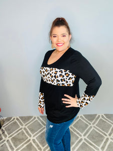 Black Long Sleeve Top with Animal Print Strip Across the Chest on and the Sleeve Cuff