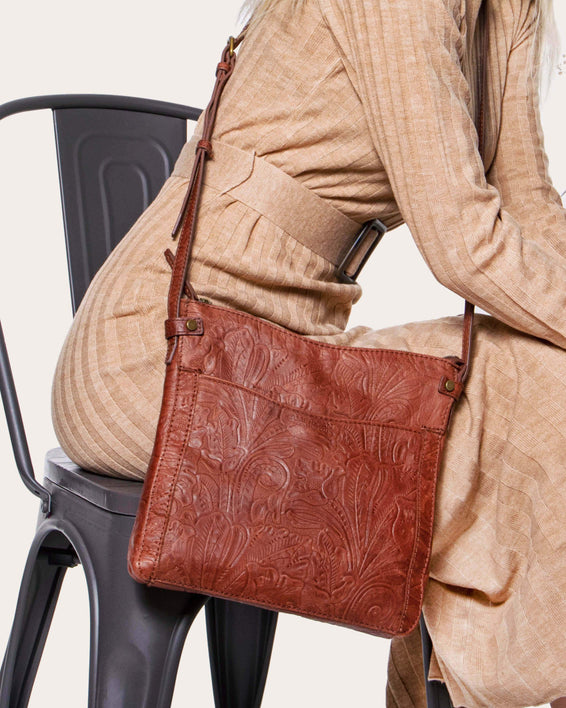 Evansville Flat Crossbody - brandy tooled lifestyle