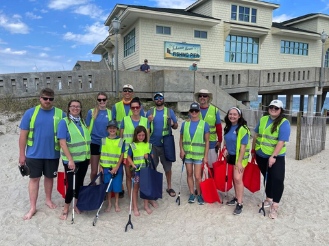 The Team from Port City Apparel gathered at the beach for a clean up effort.