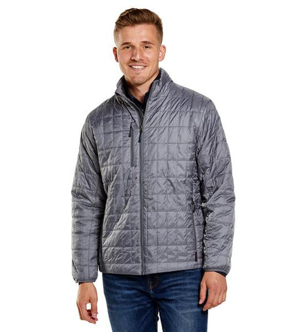 Man wearing a silver Storm Creek Ripstop Jacket from Port City Apparel