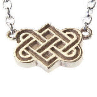 tibetan love knot pendant on chain bracelet close up