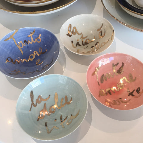 Golden Rimmed Bowls with Gold Writing