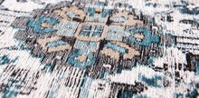 Load image into Gallery viewer, closeup of blue detail on pale faded carpet with blue detail