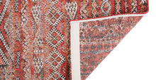 Load image into Gallery viewer, Underside of rug with Morrocan nomad pattern in red tones.