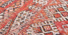 Load image into Gallery viewer, Closeup detail of rug with Morrocan nomad pattern in red tones.