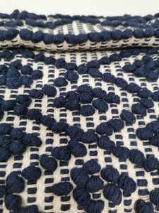 Closeup of woven detail in blue and white.