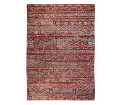 Full view of rug with Morrocan nomad pattern in red tones.