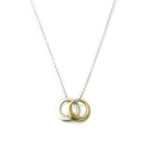 gold and silver circle pendants on chain necklae