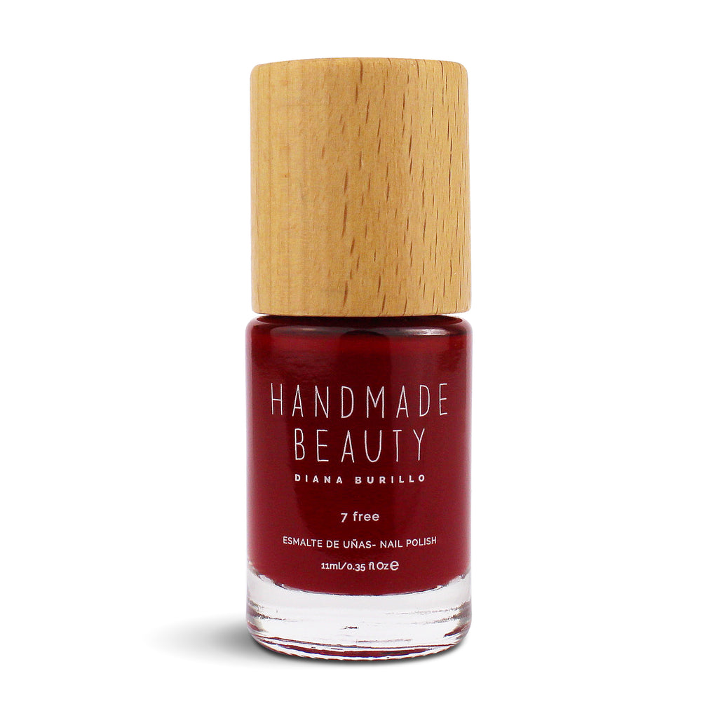 Nail Polish Non Toxic Color Apple - Handmade Beauty Nail Polish Nail Polish Non Toxic  Color Apple The color that evokes a succulent and tasty apple, irresistible for its intense color and fragrance. This bright red hides innumerable pleasures. Size: 11 ml Formulation The perfect dose of pigments in the formulation guarantees a covering effect. Contains ingredients specifically designed to strengthen nail's resistance like organic silicon. Easy Apply  Fast and precise application due to its brush. An er
