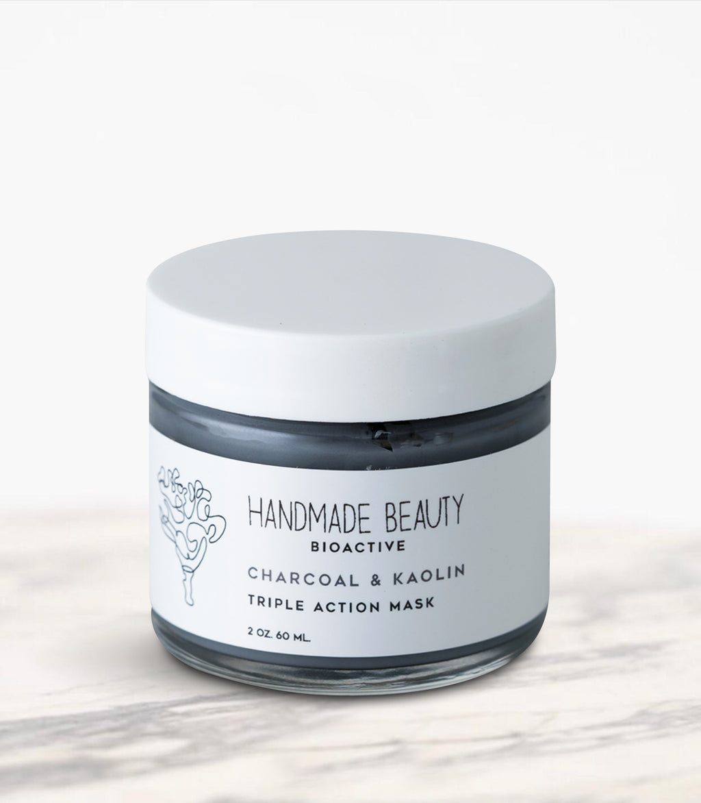 Charcoal & Kaolin Triple Action Mask 2 oz (60 ML) - Handmade Beauty Face   Charcoal & Kaolin Triple Action Mask detoxifying rose-scented mask with 3 earth clays KEY BENEFITS Eliminates oils & dirt while visibly reducing pores Gently cleanses stressed, polluted skin Leaves face feeling refreshed & radiant Charcoal Masks are one of the hottest trends in the beauty industry right now. Our powerful combination of charcoal and three triple-action clays will leave your customers with smooth, natural
