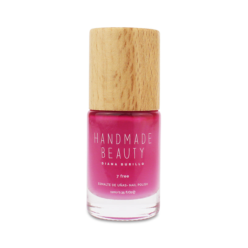 Nail Polish Non Toxic Color Pitaya - Handmade Beauty Nail Polish Nail Polish Non Toxic Color Pitaya Inspired by the exotic Dragon Fruit, this crimson pink color is able to empower our hands. Size: 11 ml Formulation The perfect dose of pigments in the formulation guarantees a covering effect. Contains ingredients specifically designed to strengthen nail's resistance like organic silicon. Easy Apply Fast and precise application due to its brush.  An ergonomic cap for easy use. How to use: to obtain an opti