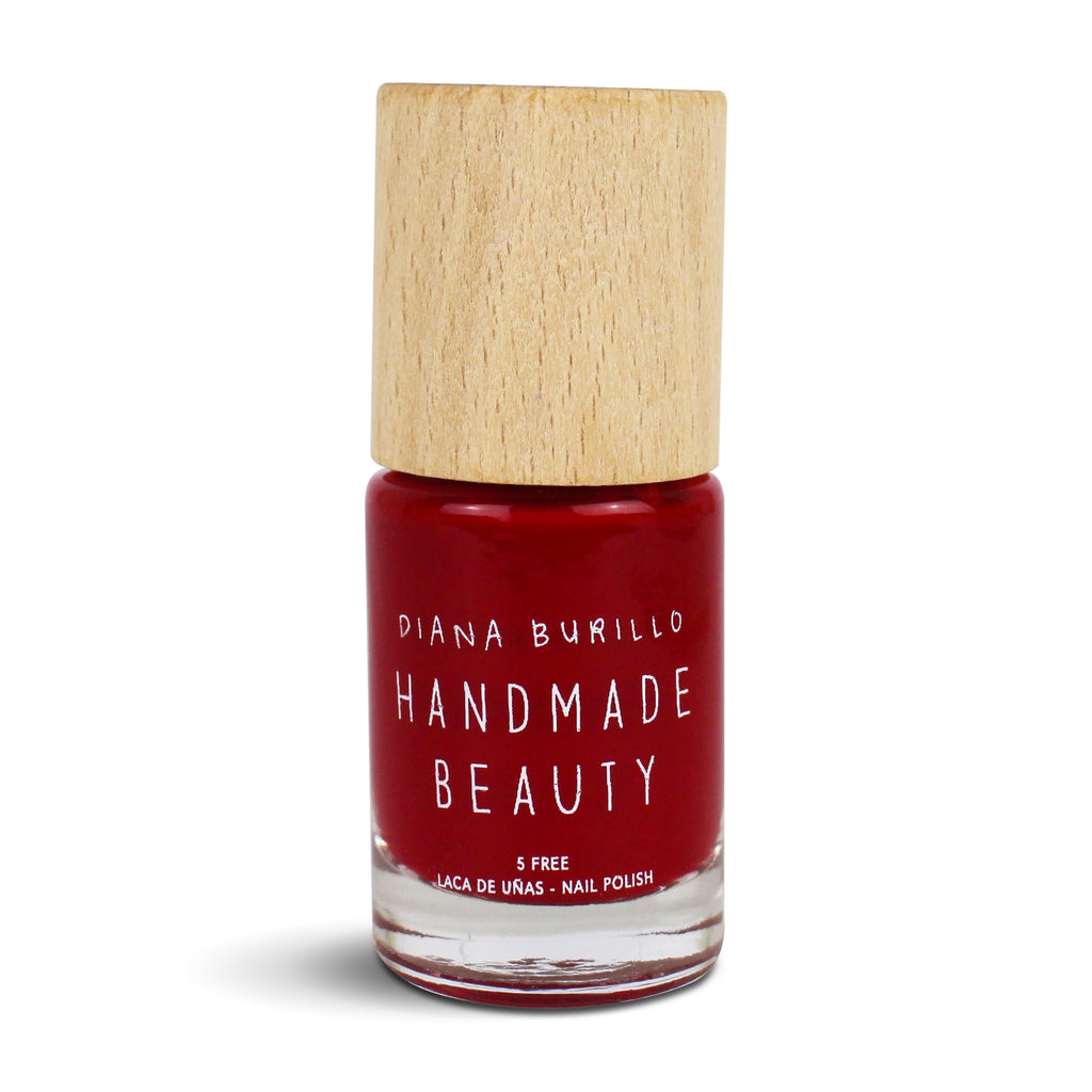 Nail Polish Non Toxic Color Pomegranate - Handmade Beauty Nail Polish Nail Polish Non Toxic Color Pomegranate  Garnet tone as the precious stones of the same name. Dark red reminiscent of the mysterious interior of pomegranates. Size: 11 ml Formulation The perfect dose of pigments in the formulation guarantees a covering effect. Contains ingredients specifically designed to strengthen nail's resistance like organic silicon. Easy Apply Fast and precise application due to its brush.  An ergonomic cap for