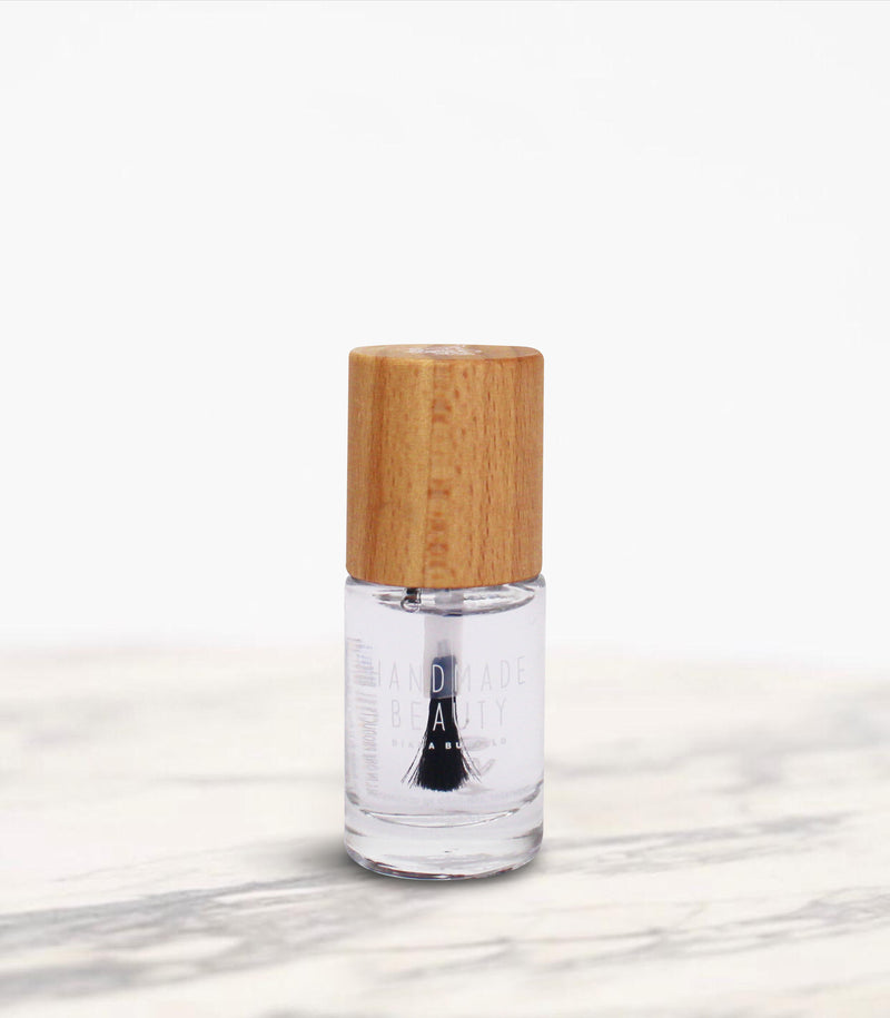 Nail Polish Non Toxic Top Coat Fast Dry - Handmade Beauty Nail Treatment Nail Polish Non Toxic Top Coat Fast Dry Its special formulation makes this Top Coat perfect to use when you do not have much time for the manicure. More than an extra fast drying time (45-55 sec), it gives a glossy finish and a good protection of the underlying nail polish. Size: 11 ml Recommended for: all types of nails, giving the polish shine and protection. How to use: apply the color you wish on the nails and wait for at least 2
