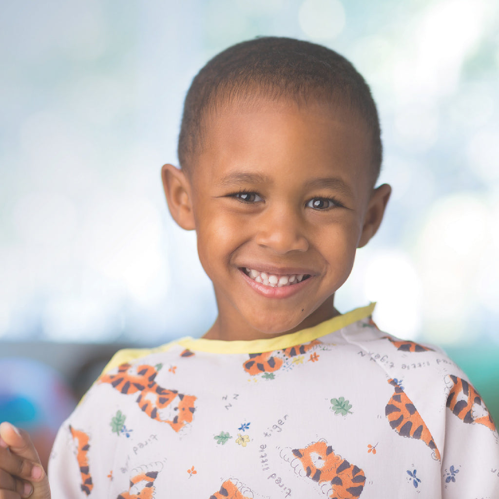 Image of young boy provided by Children's Hospital Los Angeles to support My Hand In Yours useful gifts that provide caring and comfort during the holidays