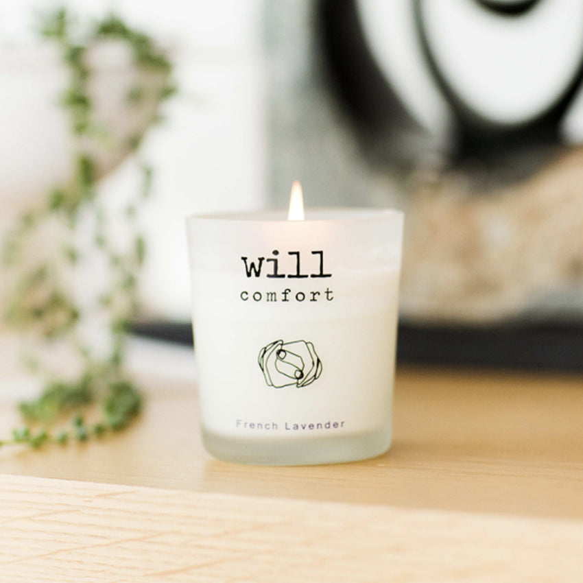 MY HAND IN YOURS™ WILL COMFORT candle lit on a wood table - designed by Finding Will - great gift for family and holidays