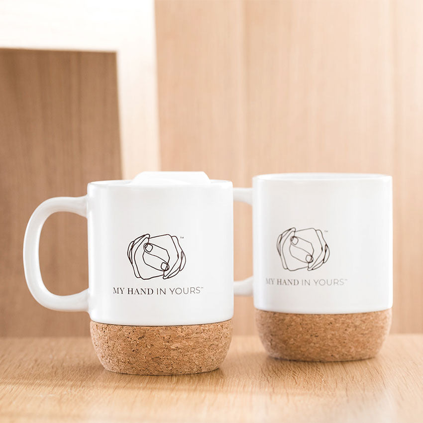 My Hand In Yours Signature ceramic and cork travel tumbler mugs side-by-side