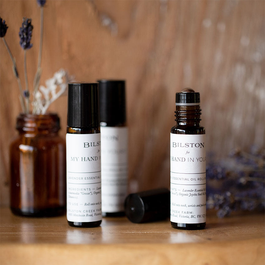MHIY™ Essential Oils pictured on a wooden shelf- Lavender Oil Roll-On produced by Bilston Creek Farm in Victoria Canada
