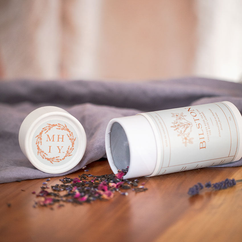 My Hand In Yours Lavender and Rose black tea pictured on a wooden table with linen by Bilston Creek Lavender Farm