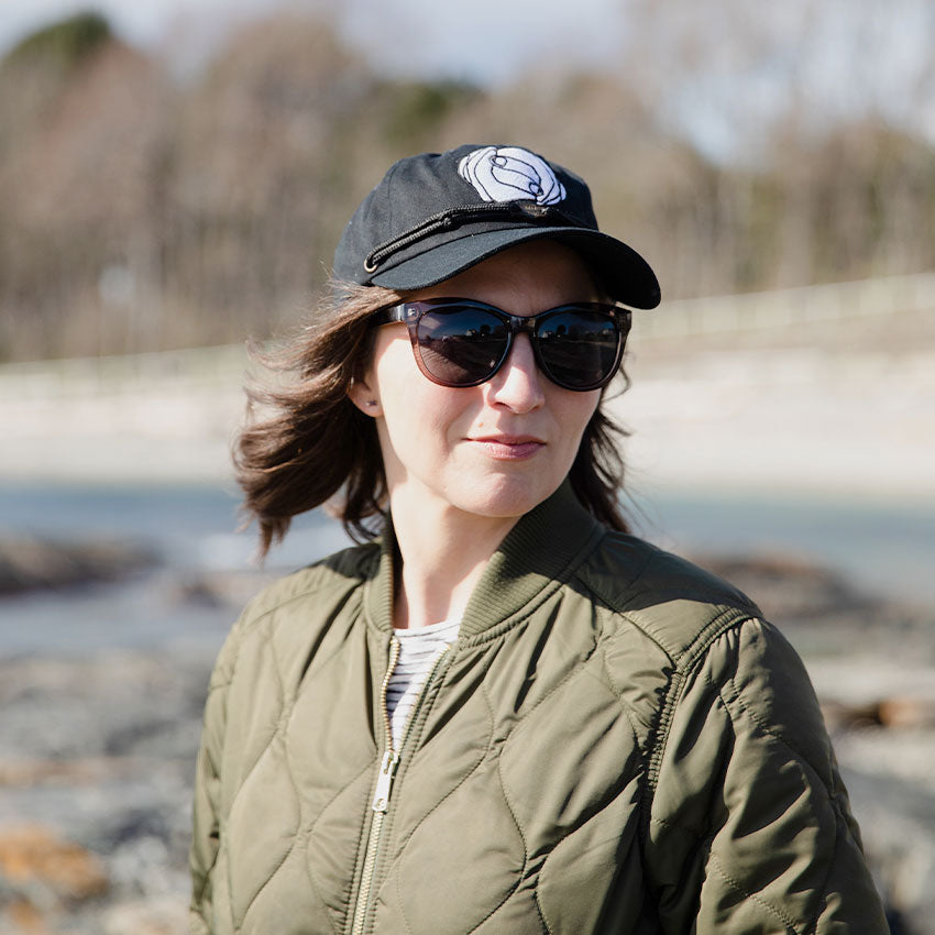 Woman wearing the MHIY™ Classic Cap created by Findlay Hats on a local beach