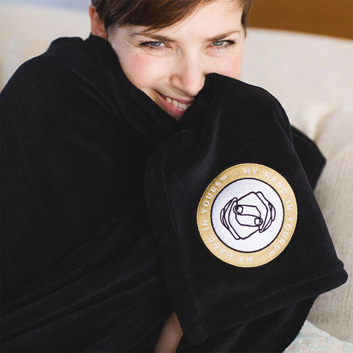 Woman wrapped in the MHIY Soft Fleece Blanket - best gifts for loved ones to offer comfort and connection