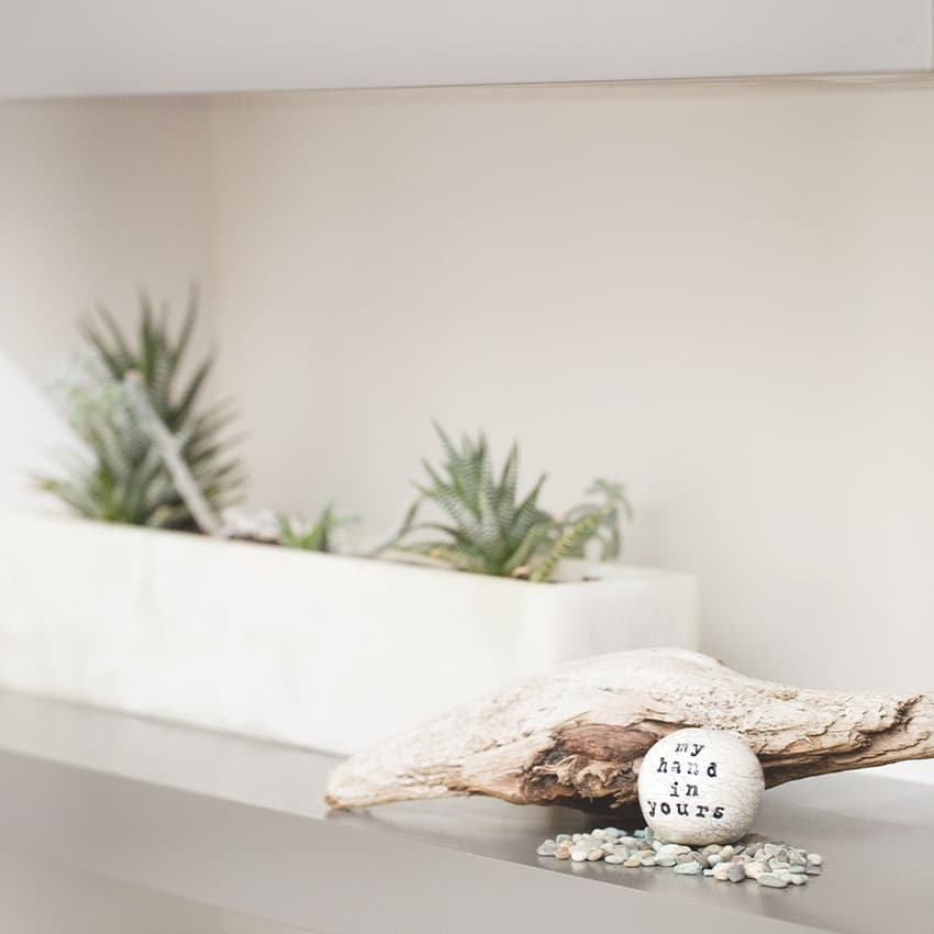 small ceramic orb in front of drift wood and planter - uncommon goods anniversary gifts