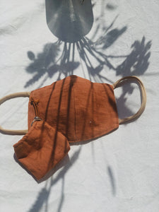 Orange face mask with a matching key case