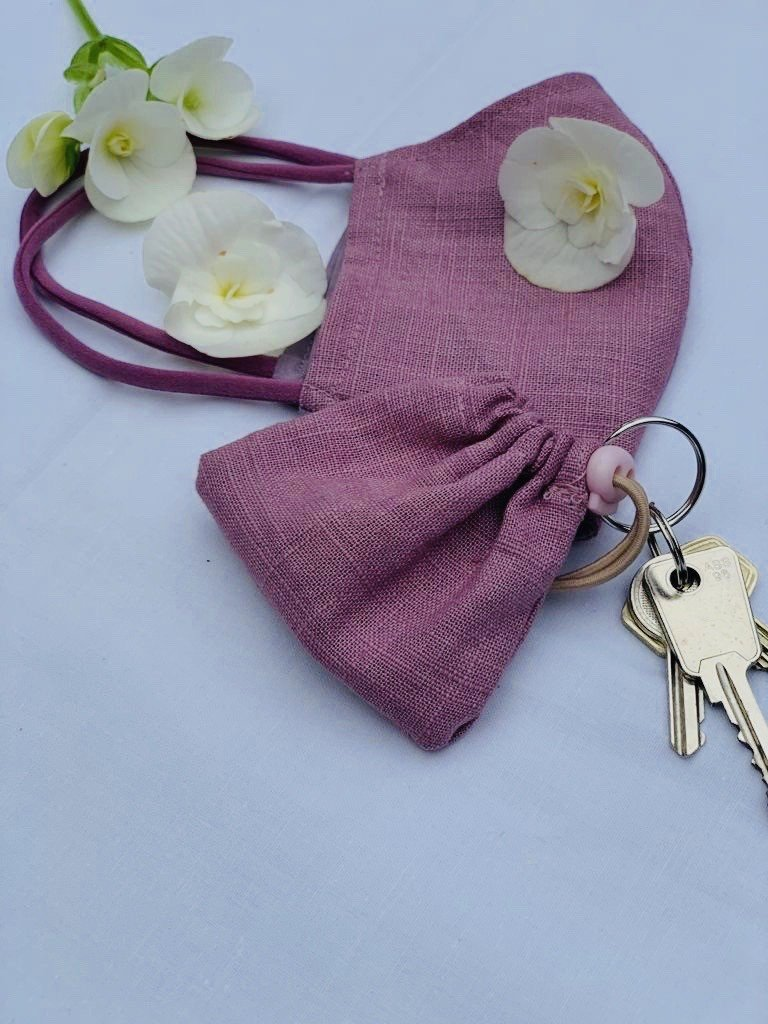 Pink face mask with a matching key case