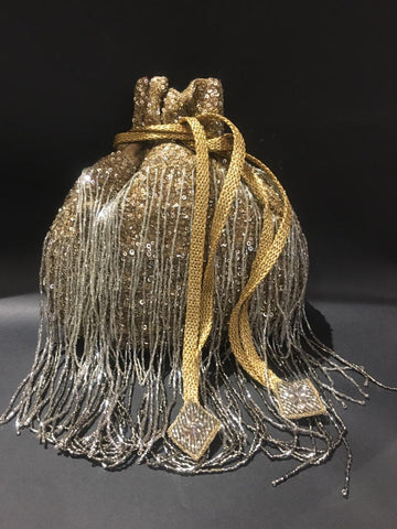 Gold Sequin Potli With Silver Tassel Embellishment