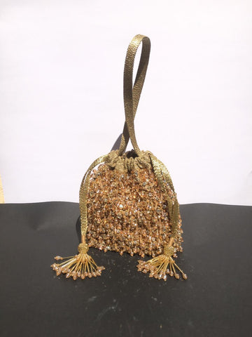 Copper Tassel Embellished Potli With Gold Wrist Strap