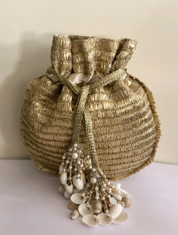 Dull Gold Potli With Shell Tassels