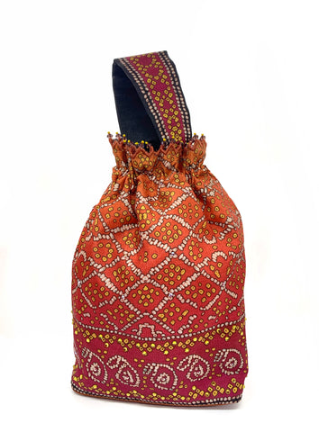 Red Bandhani Printed & Swarvoski Crystal Highlighted Potli With Detachable Wrist Strap