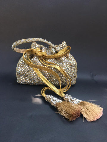 Silver Hand Embroidered Potli With Wrist Strap