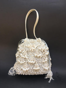 White Pearl Embellished Potli With Wrist Strap