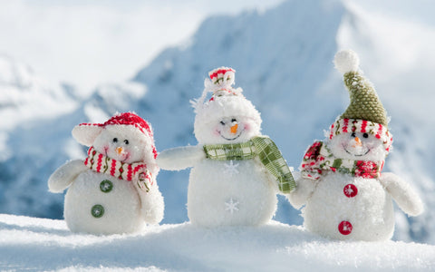 Cute and cosy snowmen