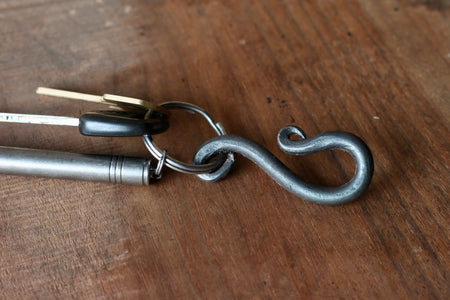 a blacksmith hand forged belt-loop keychain by Wicks Forge