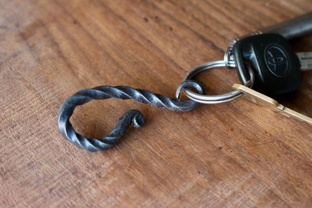 a blacksmith hand forged belt-loop keychain with a twist design by Wicks Forge
