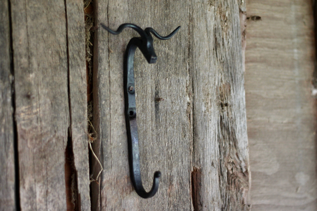A blacksmith hand forged Longhorn style animal head hook by Wicks Forge