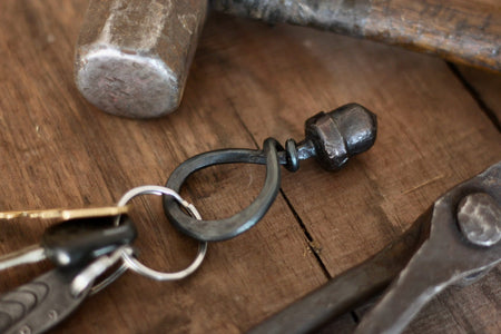 a blacksmith hand forged steel acorn keychain by Wicks Forge