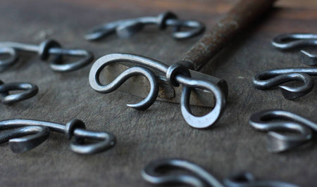 a blacksmith hand forged bottle opener by Wicks Forge