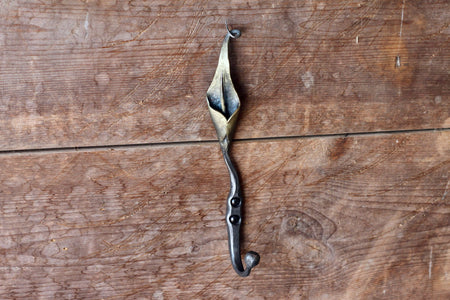 a blacksmith hand forged hook with a Calla Lily Flower detail by Wicks Forge