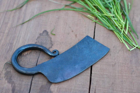 a blacksmith hand forged herb chopper by Wicks Forge