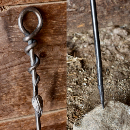 a blacksmith hand forged fire poker with a leaf wrap design by Wicks Forge