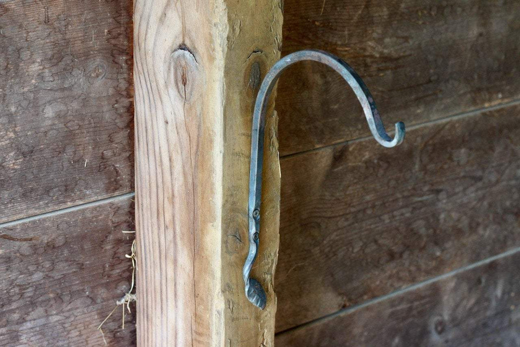 a blacksmith hand forged plant hanger with a leaf design by Wicks Forge