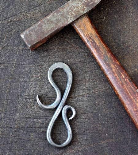 a blacksmith hand forged small keychain bottle opener by Wicks Forge