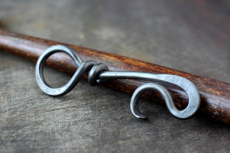 a blacksmith hand forged keychain bottle opener by Wicks Forge