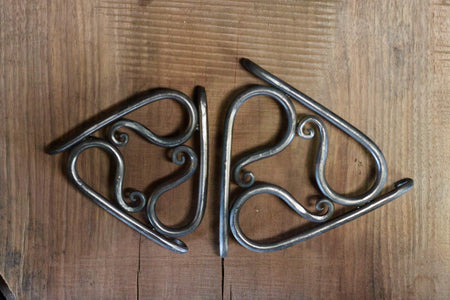 a 4 inch and 7 inch blacksmith hand forged trivet pot holder by Wicks Forge