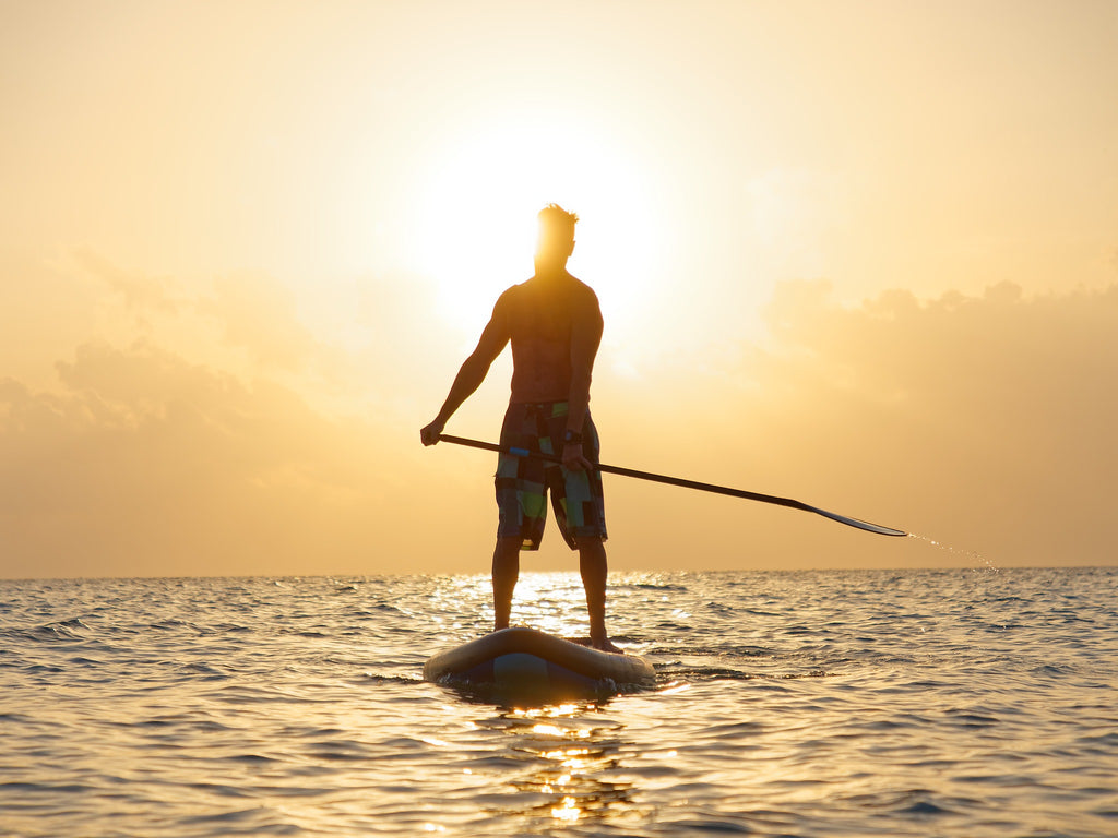 Paddling at sunset on a performance SUP board